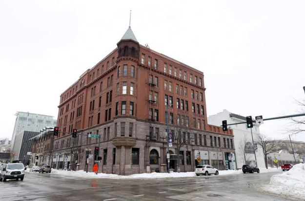 The former Guaranty Bank building in Cedar Rapids on Wednesday, Feb. 20, 2019. Heart of America Group plans to redevelop the 300 block of 3rd Ave SE, with a hotel in the renovated bank building, renovation of the World theater and construction of a new hotel building. (Liz Martin/The Gazette)