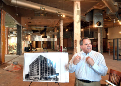 Kirk Whalen presenting the 5th avenue building in downtown Moline, Illinois